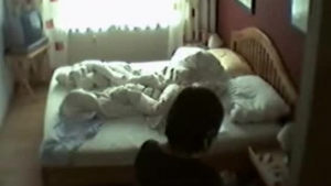 Mature blonde woman is masturbating in front of her web camera, in front of the camera